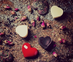 Chocolate candies heart shaped with dry tea roses at stone background for Valentine's Day. - make your marriage solid
