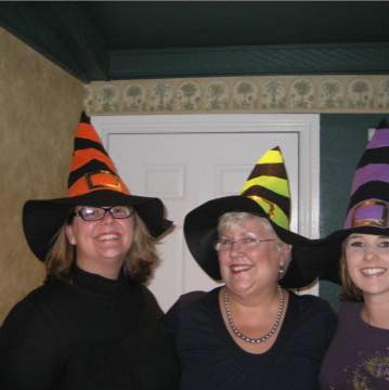 three women in witches hats - hate about October
