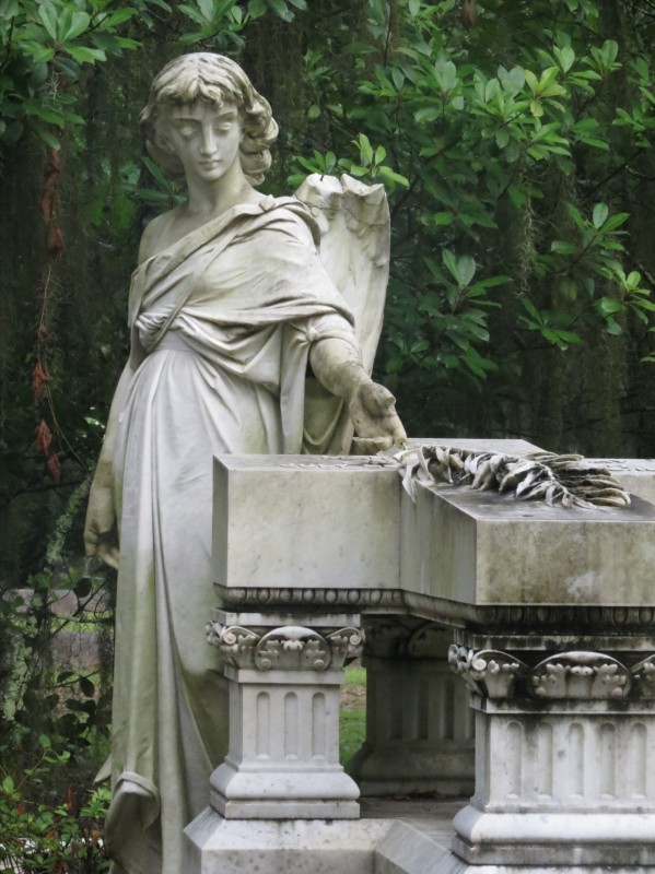Angel touching a tombstone - New Orleans family adventures