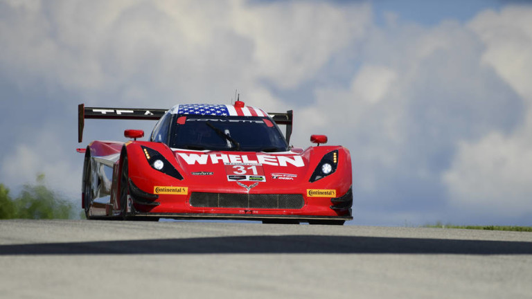 red race car with smoke behind it - IMSA racing