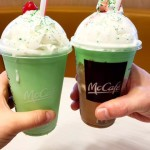 two hands each holding McDonald's cups - McDonald's Shamrock Shake