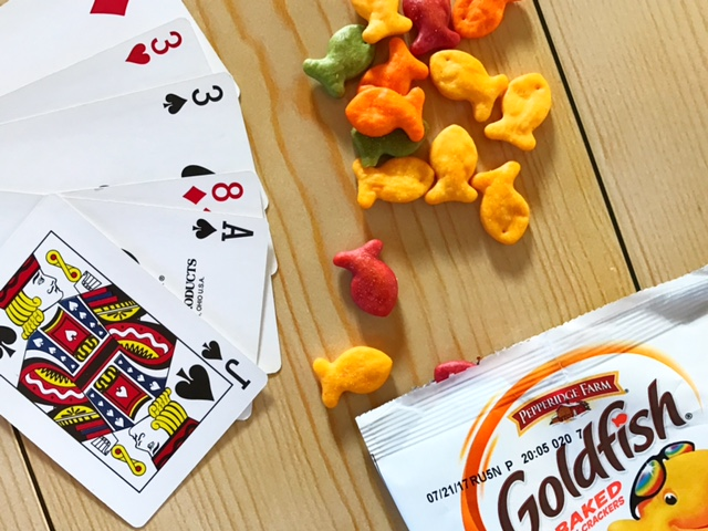 hand of cards on a table with crackers - awesome indoor games