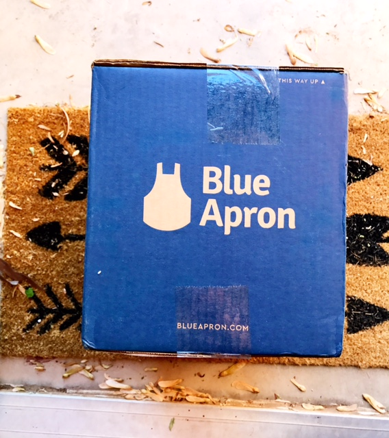 blue apron box on door step - blue apron meal planning