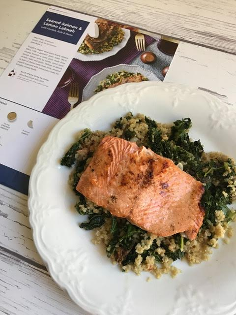 white plate with grilled salmon - blue apron meal planning