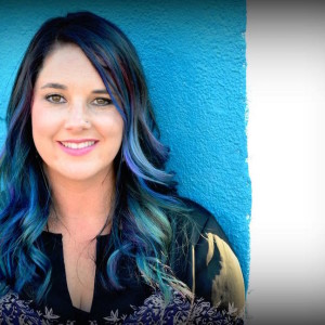 blue haired girl in front of blue wall - loving yourself