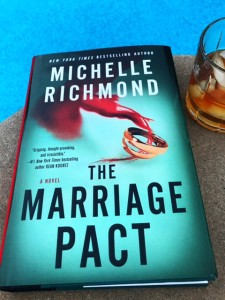 hardback book beside a pool - the marriage pact