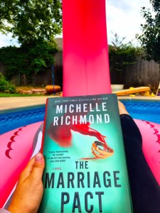 closed hard back book on pool float - the marriage pact