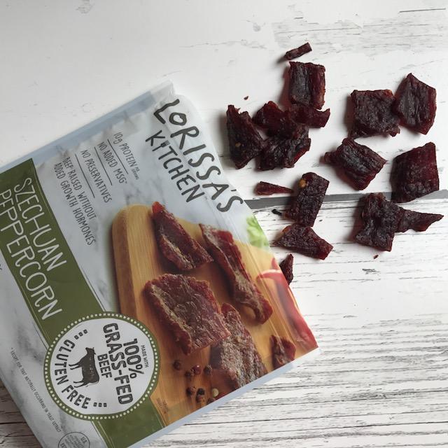 spilled bag of beef jerky - road trip essentials