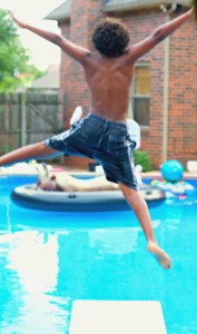 boy jumping off a diving board - being a boy mom