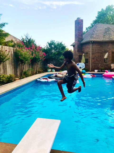 boy jumping into a swimming pool - being a boy mom
