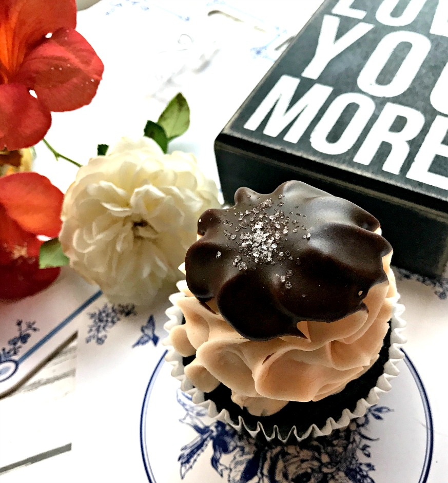 cupcake and flowers on white table - planning date nights