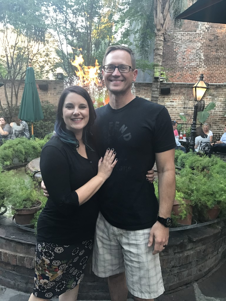 couple in front of Pat O'Brien fountain in New Orleans - planning date nights