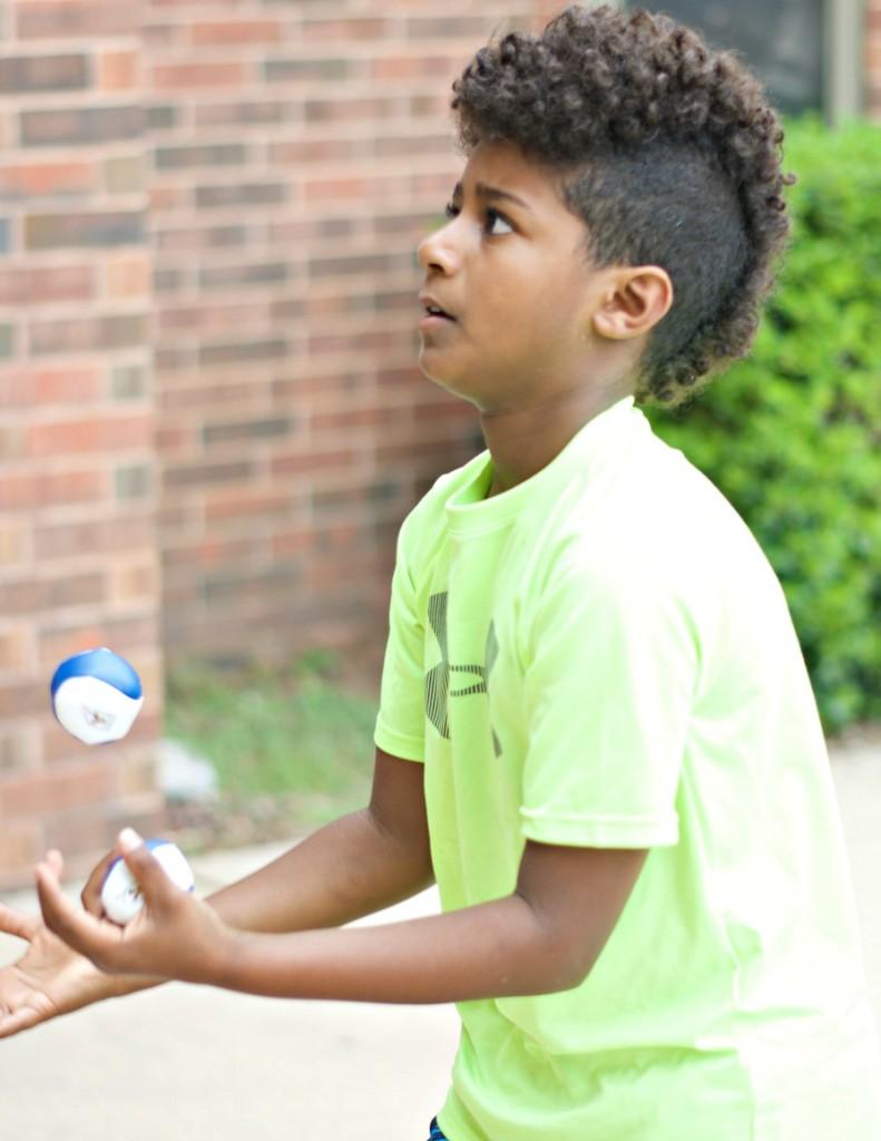 kid juggling two balls - kids helping kids