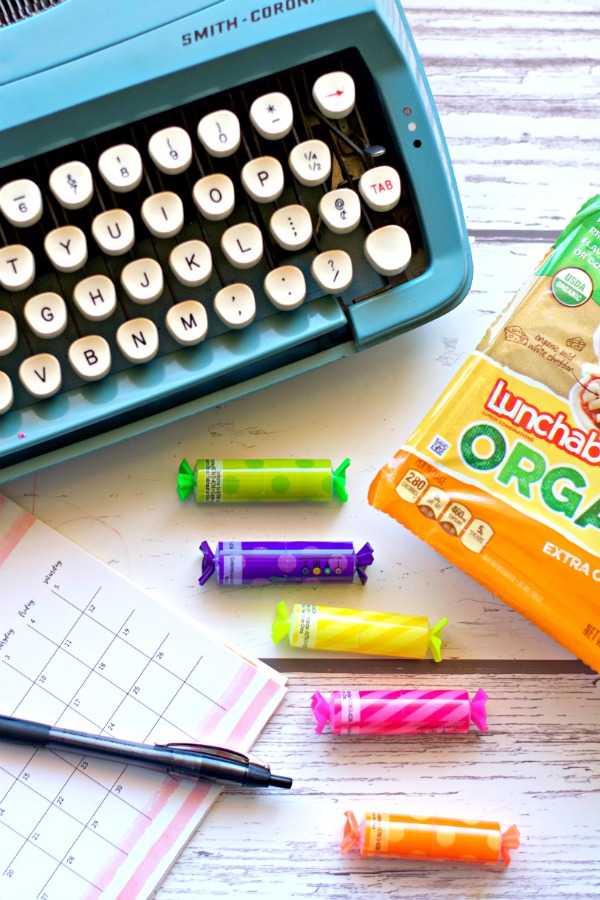lunchable on a table with vintage blue typewriter - mastering junior high