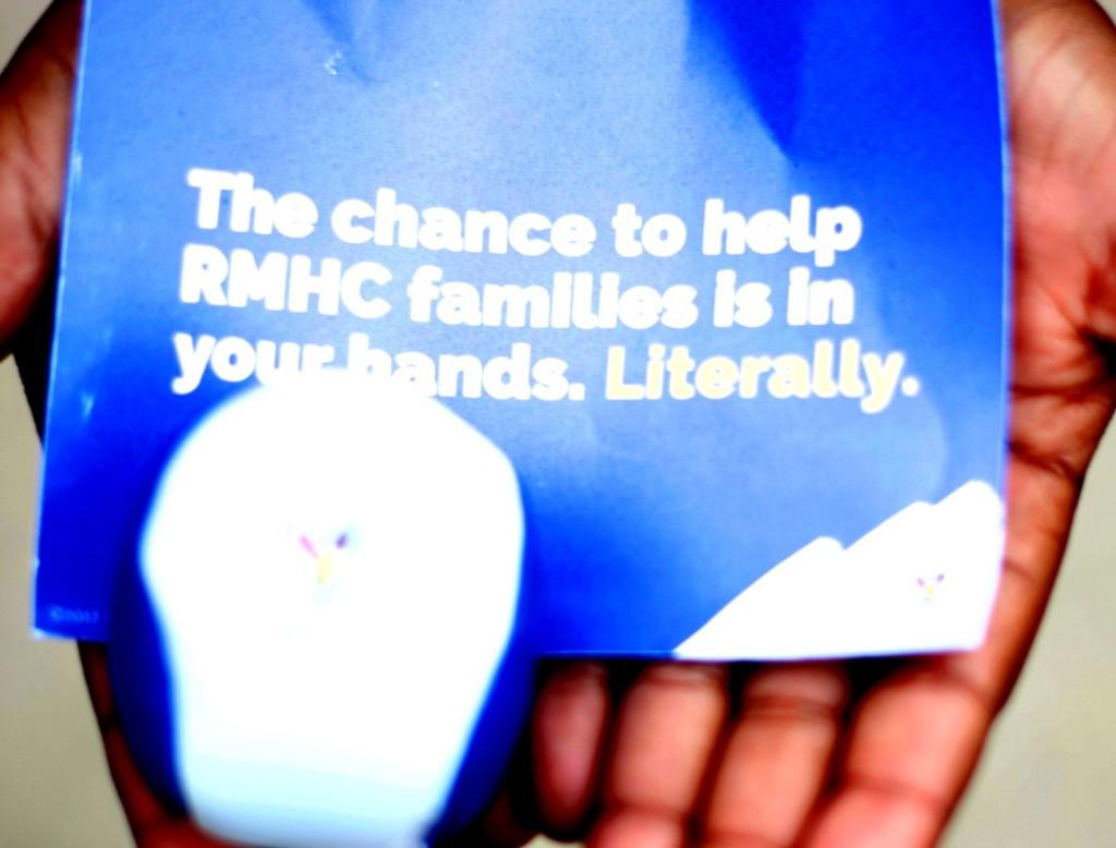 a child's open hands - kids helping kids