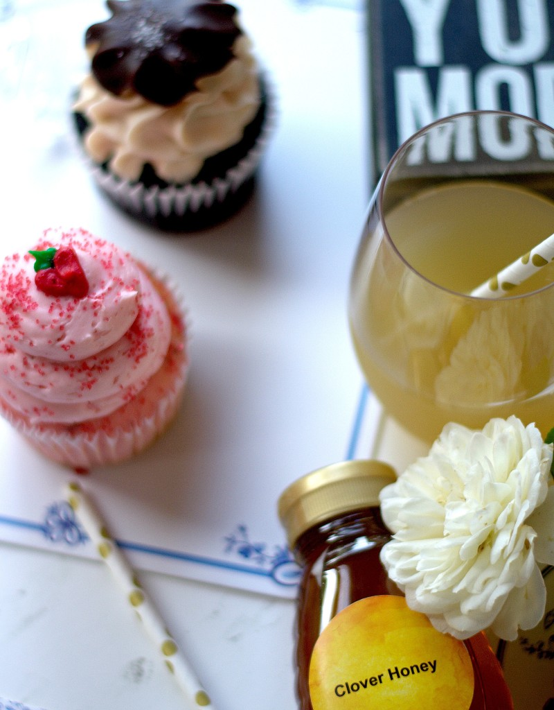 cupcakes and drinks on a white wooden table - planning date nights